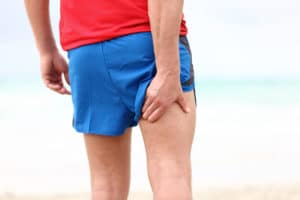 Running sports injury. Pulled muscle, muscle strain or muscle cr